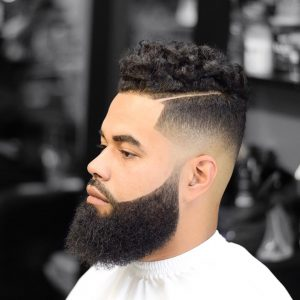 curls with hard part and fade