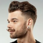 slicked curly hairstyle